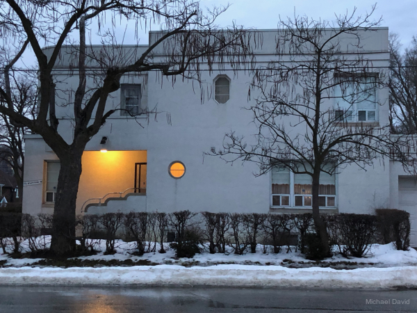 Frozen Art Deco home at dusk