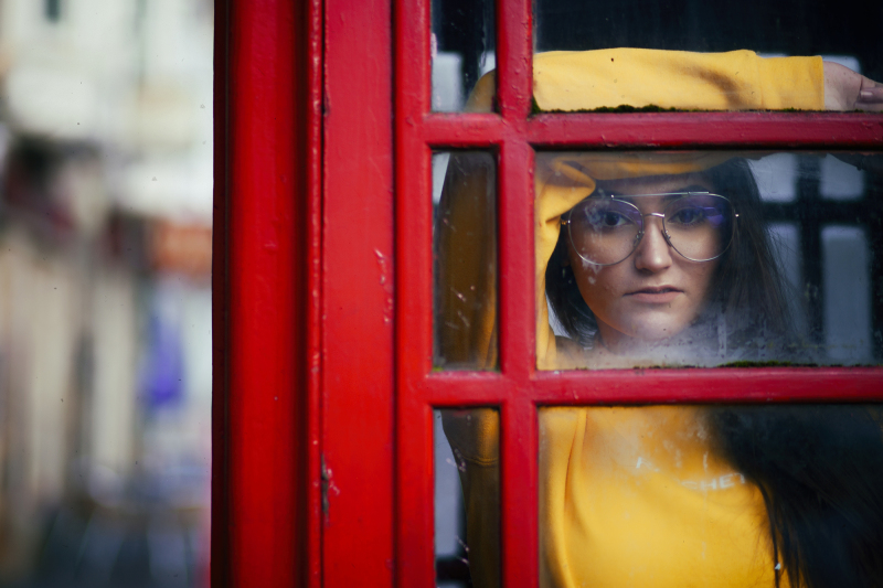 Girl in phonebox