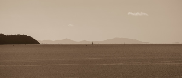 Sepia of boats near Little Barrier Island