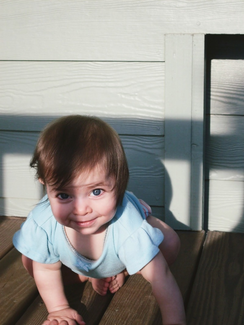 toes kiss under baby, one blue eye illuminated