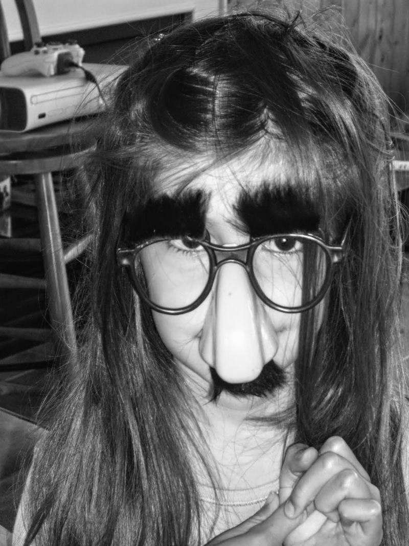 girl with groucho marx glasses smile black n white