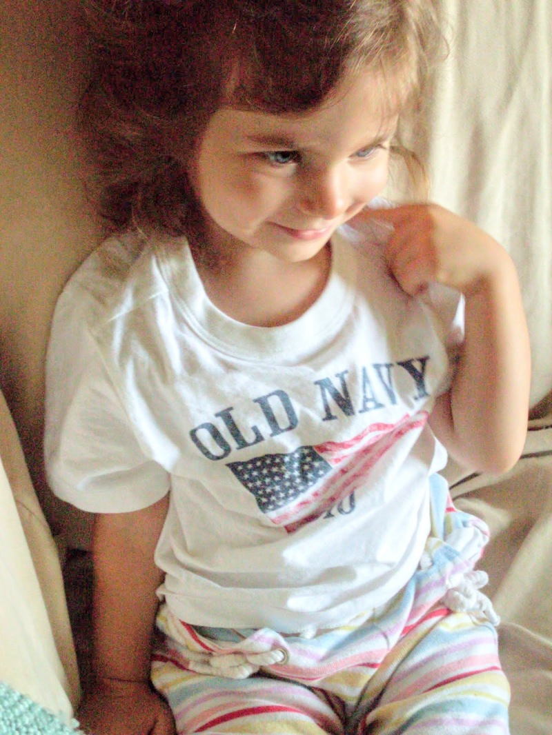 girl w/ blue eyes, american flag, smile, red white