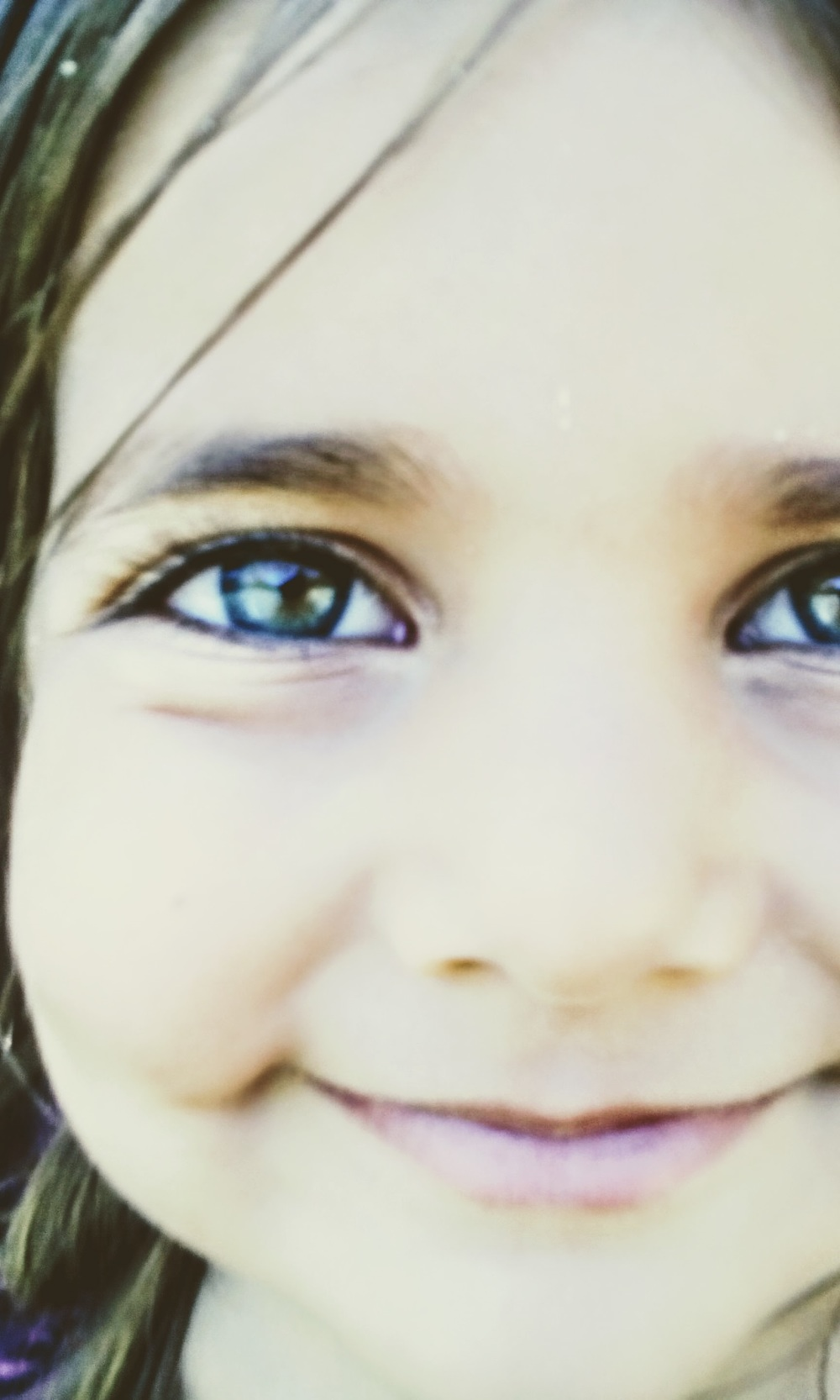 close up girl's face beautiful green eyes smile