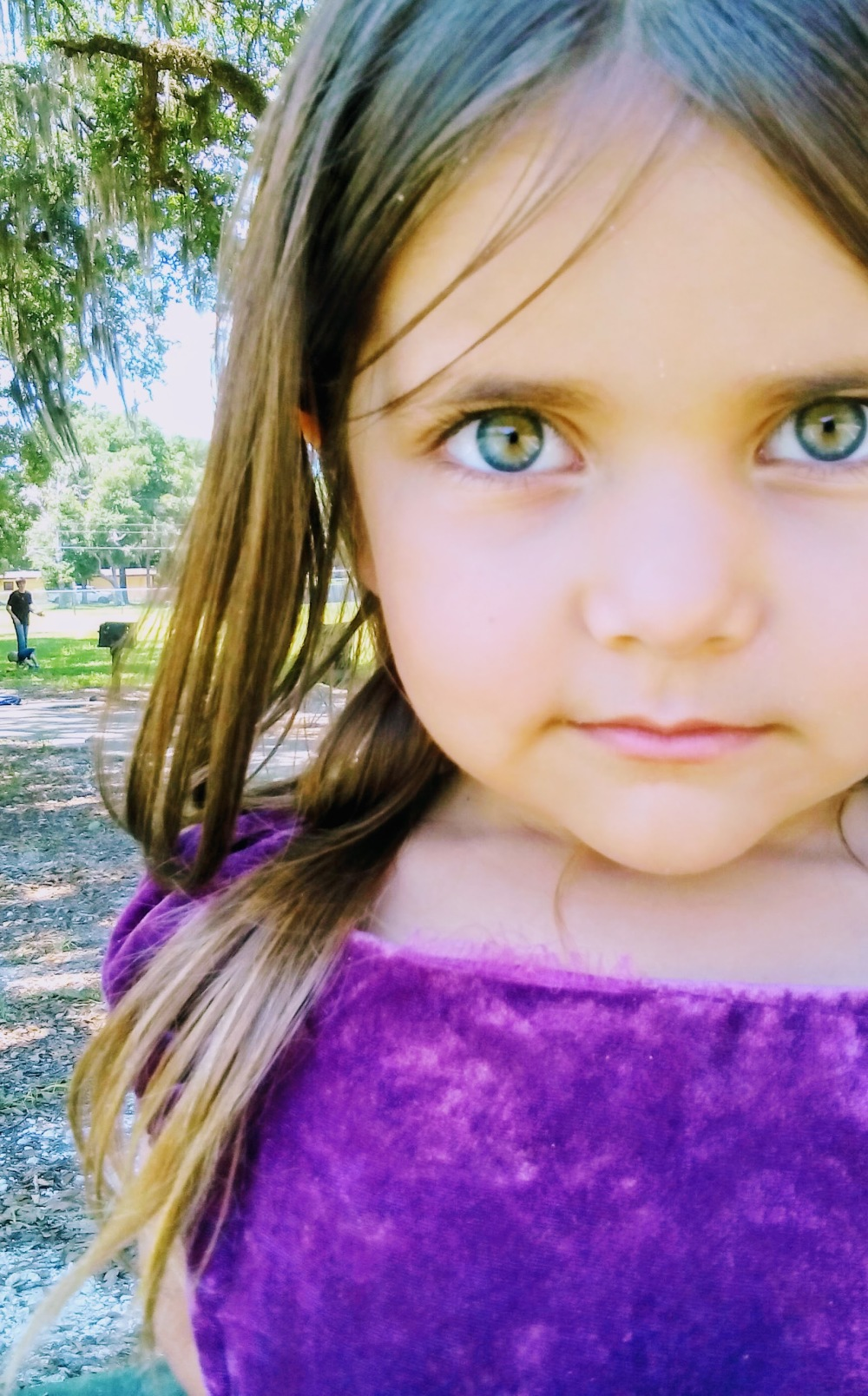 girl with amazing green eyes in purple dress