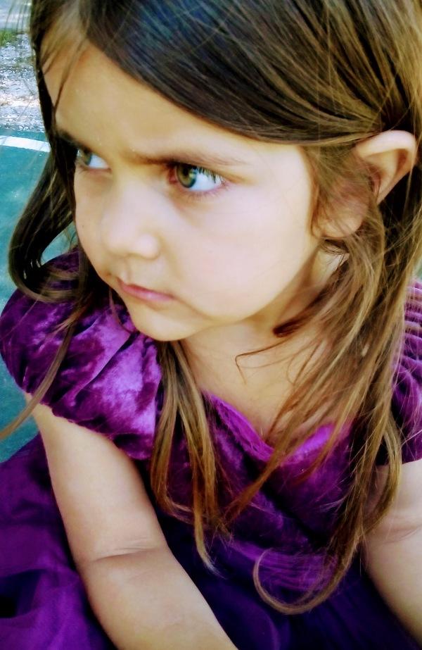 serious girl purple dress beautiful green eyes