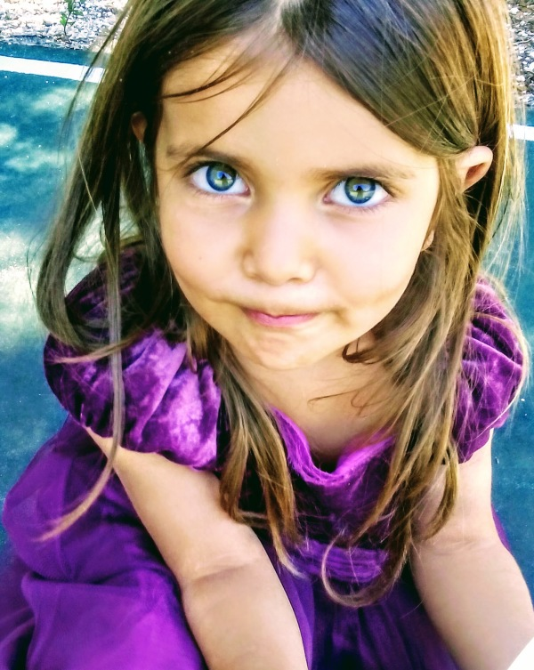 girl with purple dress green eyes