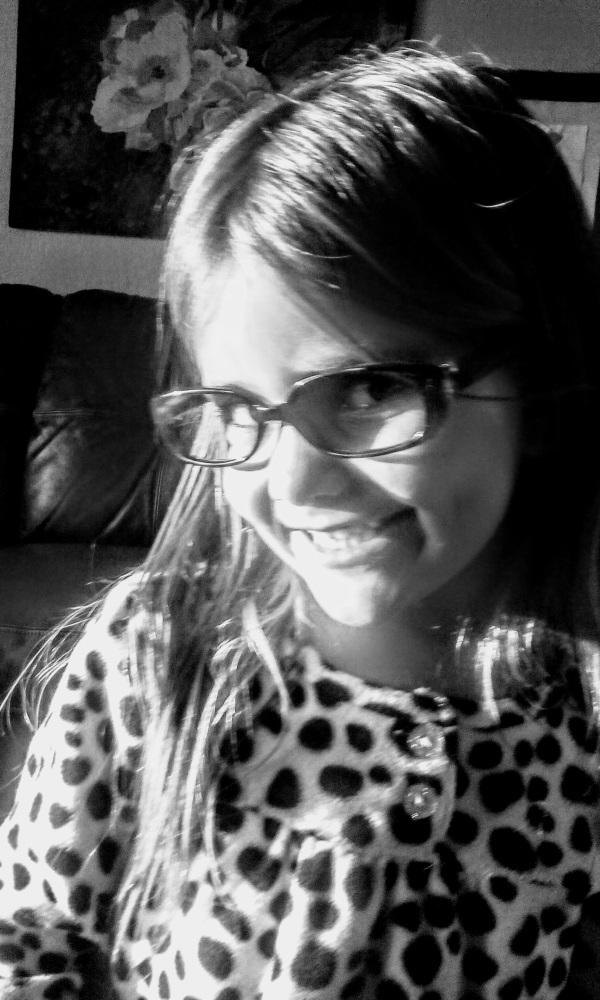 girl smiling fake glasses black and white