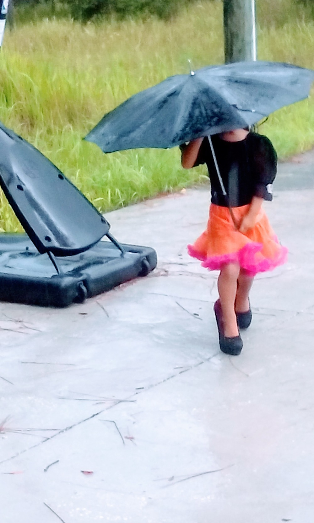 girl with orange skirt and umbrella