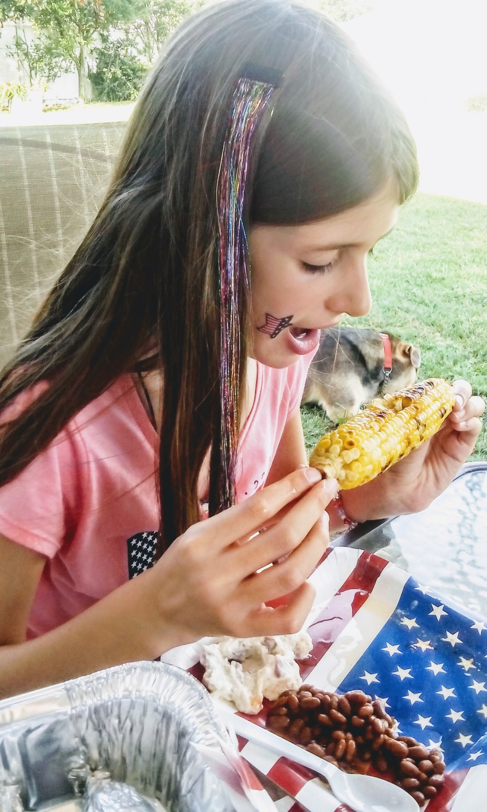 girl eating corn on the cob 4th of july