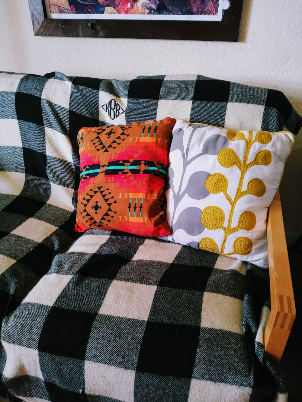 Two Pillows on Checkered Blanket