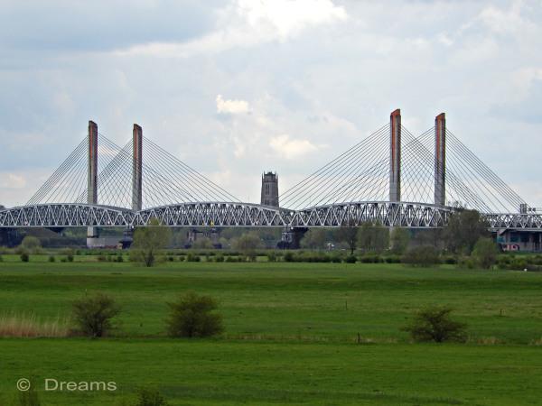 The bridge from the dike at Neerijnen .