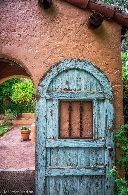Weathered blue courtyard door at La Posada in Wins