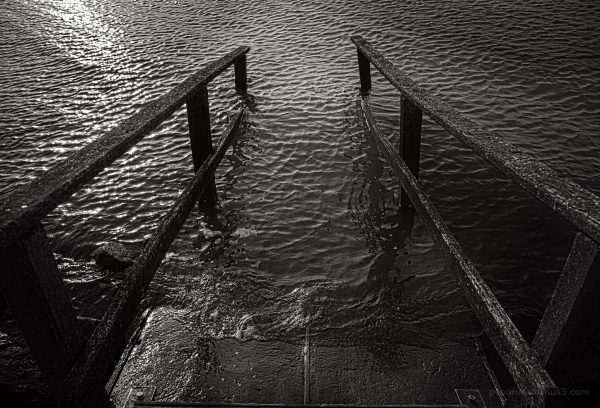 A stairway leads into the sea
