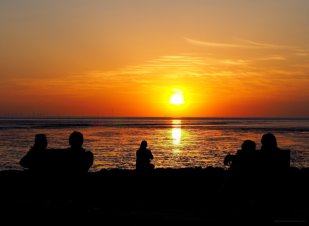 Sunset at the beach with people
