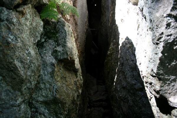 a tight squeeze through a cave.