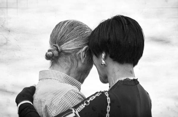 An affectionate couple photographed from behind