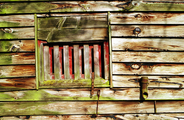 Colourful, decaying side of a barn