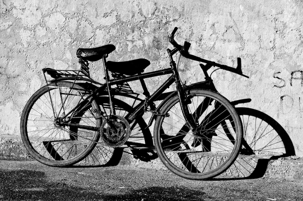 Bicycle merging with its shadow