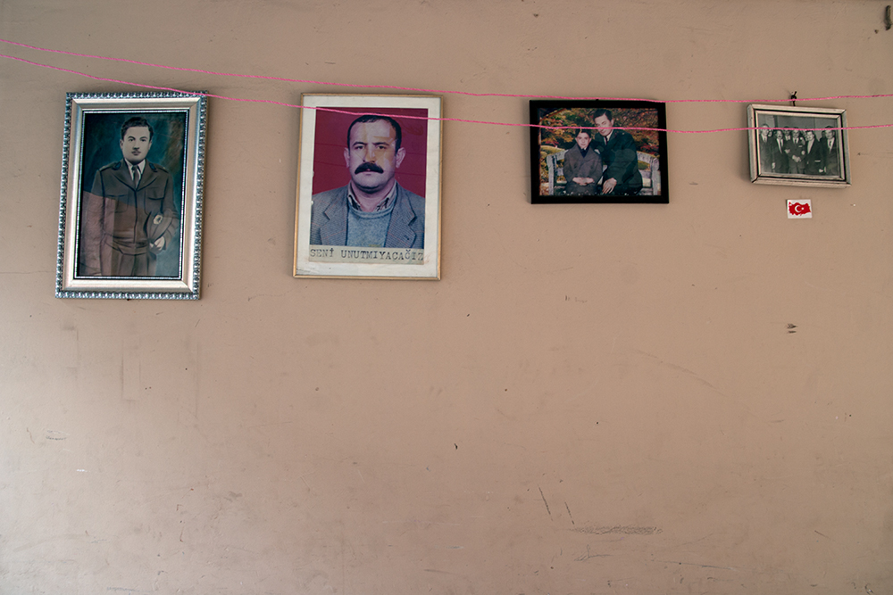 Pictures hanging on the wall of a Turkish house