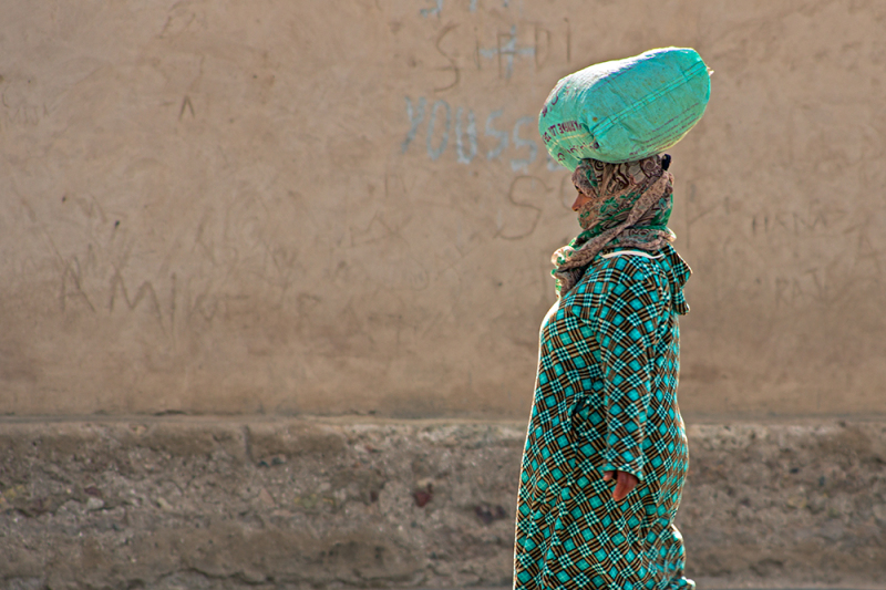 Moroccan woman carrying goods on her head