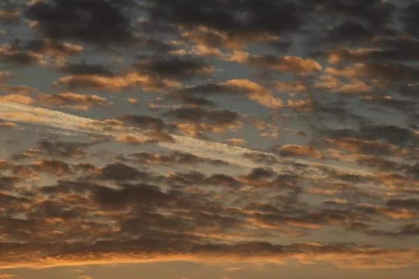 Un  de  ciel  nuageux...