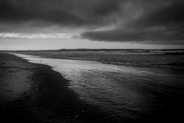 Rain Clouds On The Beach