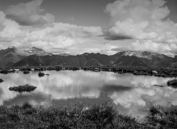 ...a lake in the alps under heavy clouds...
