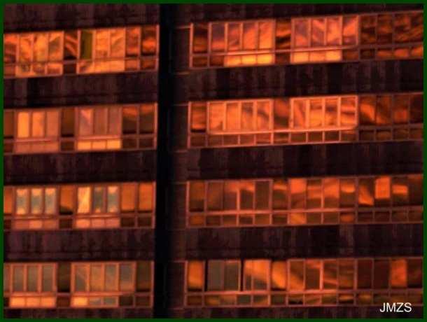 Dawn light on glass windows of Atotxa tower